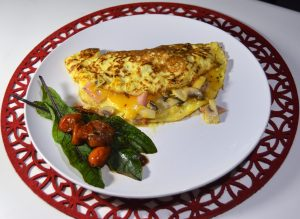 Our Omelette's are filled with mushrooms, cheese, bacon and fried cherry tomatoes. Feel free to leave out any ingredients during your order. Served with a glass of fruit juice.